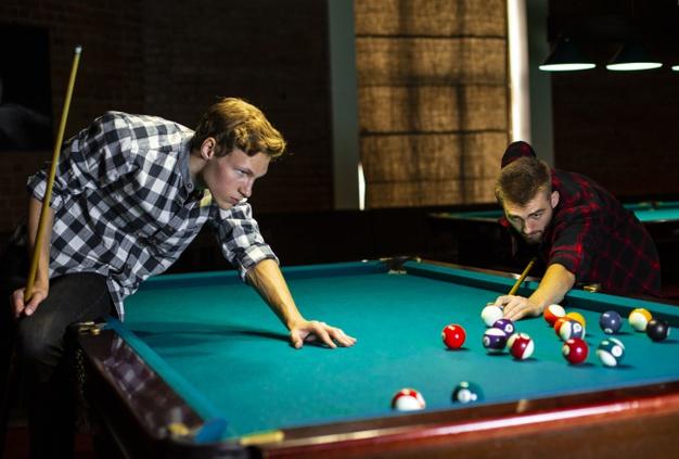 medium-shot-boys-playing-billiard-together_23-2148299199